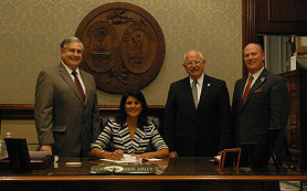 bill-sandifer-nikki-haley-signing
